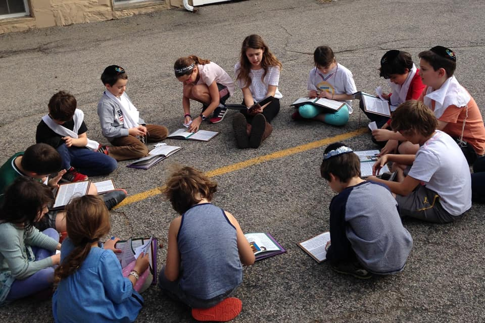 Children Studying on the road