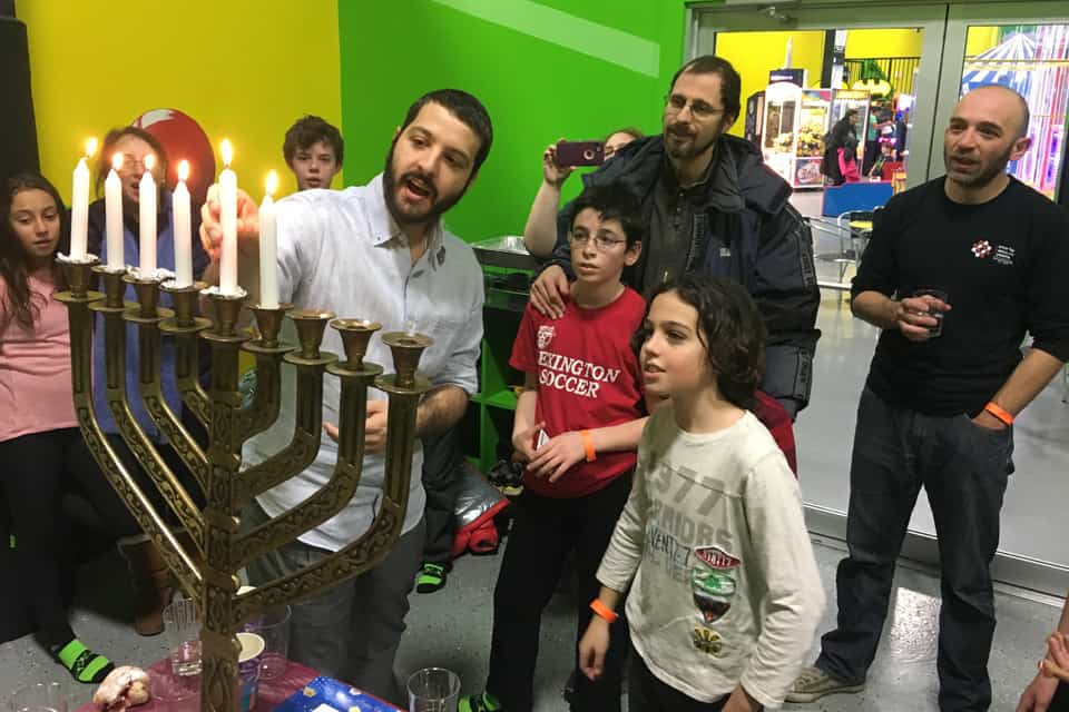 Teacher showing kids the candles